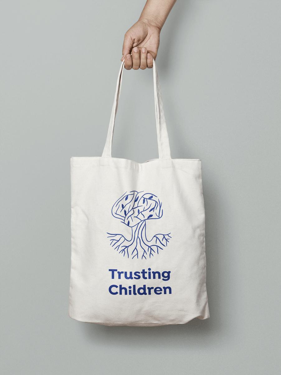 Trusting Children Logo on Tote Bag